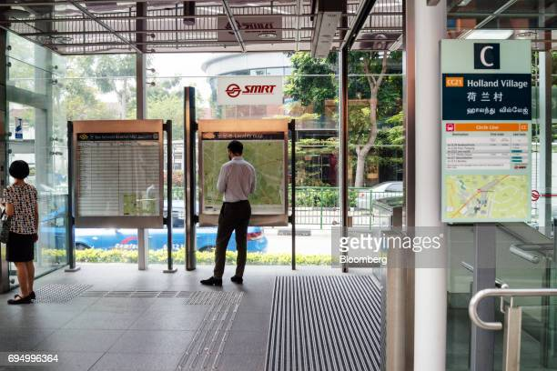 A passenger browses a map inside the SMRT Corp Holland Village train station in the Holland Park area of Singapore on Monday June 5 2017 After two...