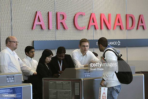 A passenger checks in for an Air Canada flight at O'Hare International Airport February 3 2011 in Chicago Illinois Commercial carriers at the airport...