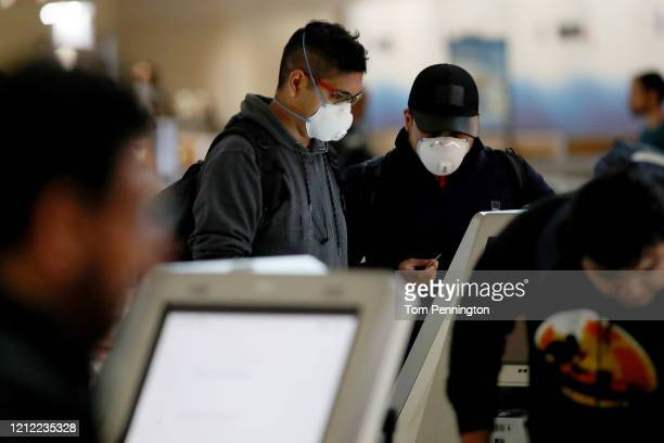 Passenger checks in for an American Airlines in Terminal D at Dallas/Fort Worth International Airport on March 13, 2020 in Dallas, Texas. American...
