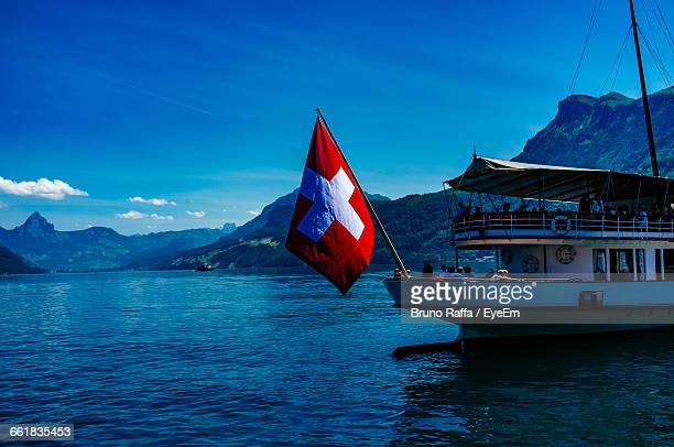 Passenger Craft With Flag On Lake