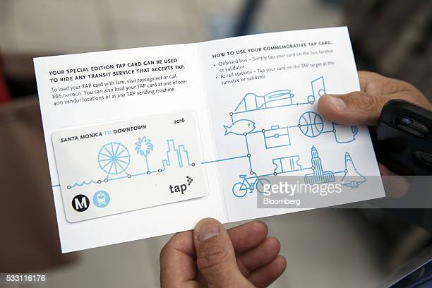 A passenger displays a TAP fare card at the Metro Expo Line light rail station in Santa Monica California US on Friday May 20 2016 The extension...