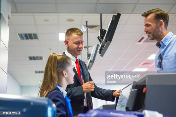 passenger doing check-in for flight at airport - airfield stock pictures, royalty-free photos & images