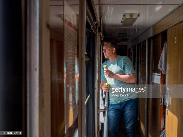 A passenger eats an ice cream on the TransSiberian Railway from MoscowVladivostok Spanning a length of 9289km it's the longest uninterrupted single...