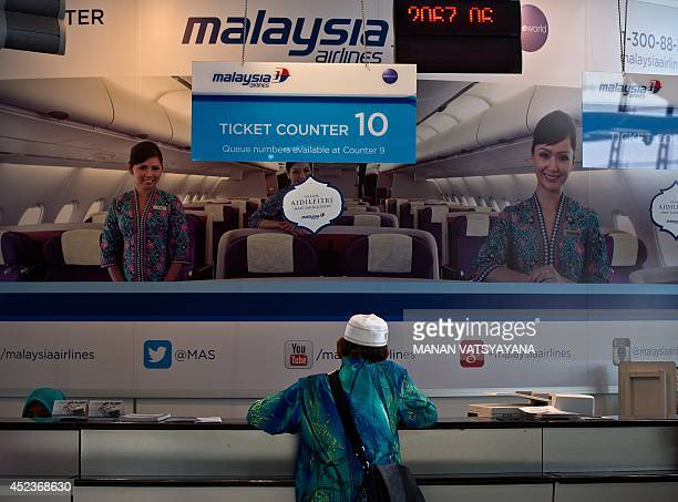 A passenger enquires for tickets at a Malaysia Airlines counter at Kuala Lumpur International Airport in Sepang on July 19 2014 A Malaysia Airlines...