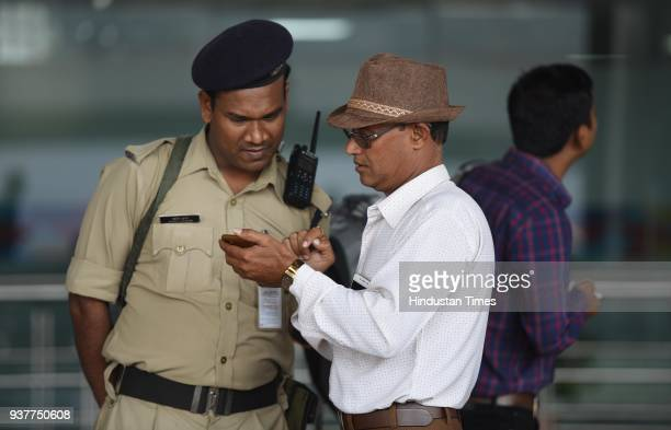 A passenger enquires from CISF Jawan after IndiGo and SpiceJet airlines have partially moved their operations from T1 to the newly revamped T2 on...