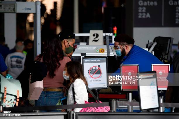 Passenger enters a Transportation Security Administration checkpoint during the Covid-19 pandemic at Los Angeles International Airport in Los...