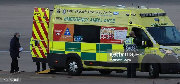 A passenger enters an ambulance after being one of the first to disembark at Birmingham Airport on March 11 2020 in Birmingham England The Grand...