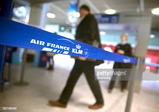 A passenger enters the Air Francebranded checkin area part of the Air FranceKLM Group at ToulouseBlagnac airport in Toulouse France on Tuesday Feb 19...