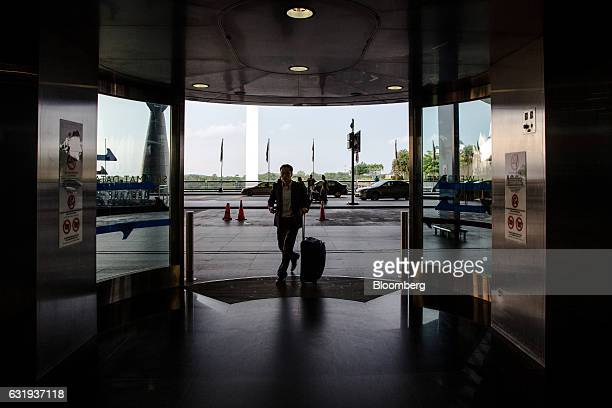 A passenger enters the checkin hall at Kuala Lumpur International Airport in Sepang Selangor Malaysia on Tuesday Jan 17 2017 The hunt for Malaysia...
