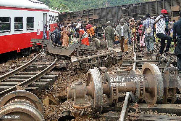 Passenger escape the site of a train derailment in Eseka on October 21, 2016. Fifty-three were killed and over 300 injured when a packed Cameroon...