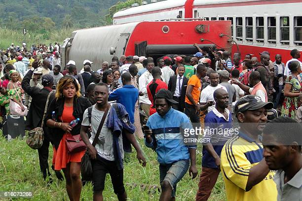 Passenger escape the site of a train derailment in Eseka on October 21 2016 Fiftythree were killed and over 300 injured when a packed Cameroon...