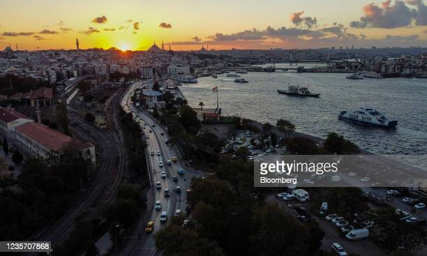 Passenger ferries sail along the Bosphorus strait during the evening sunset in Istanbul, Turkey, on Monday, Oct. 4, 2021. Turkey's consumer inflation...