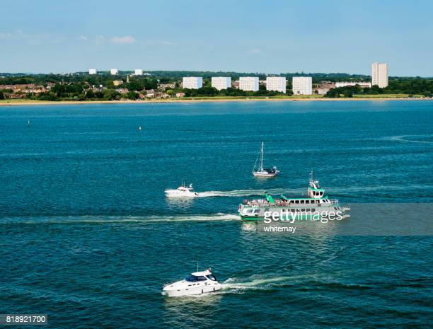 passenger ferry and leisure craft in southampton water - southampton water stock photos and pictures