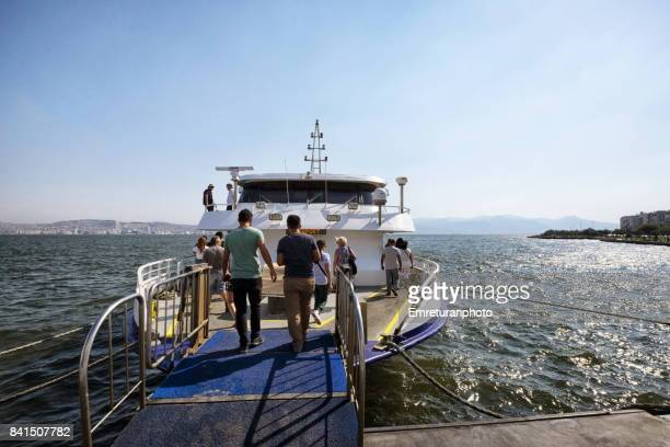 passenger ferry operating between karsiyaka and alsancak districts in izmir. - emreturanphoto stock pictures, royalty-free photos & images