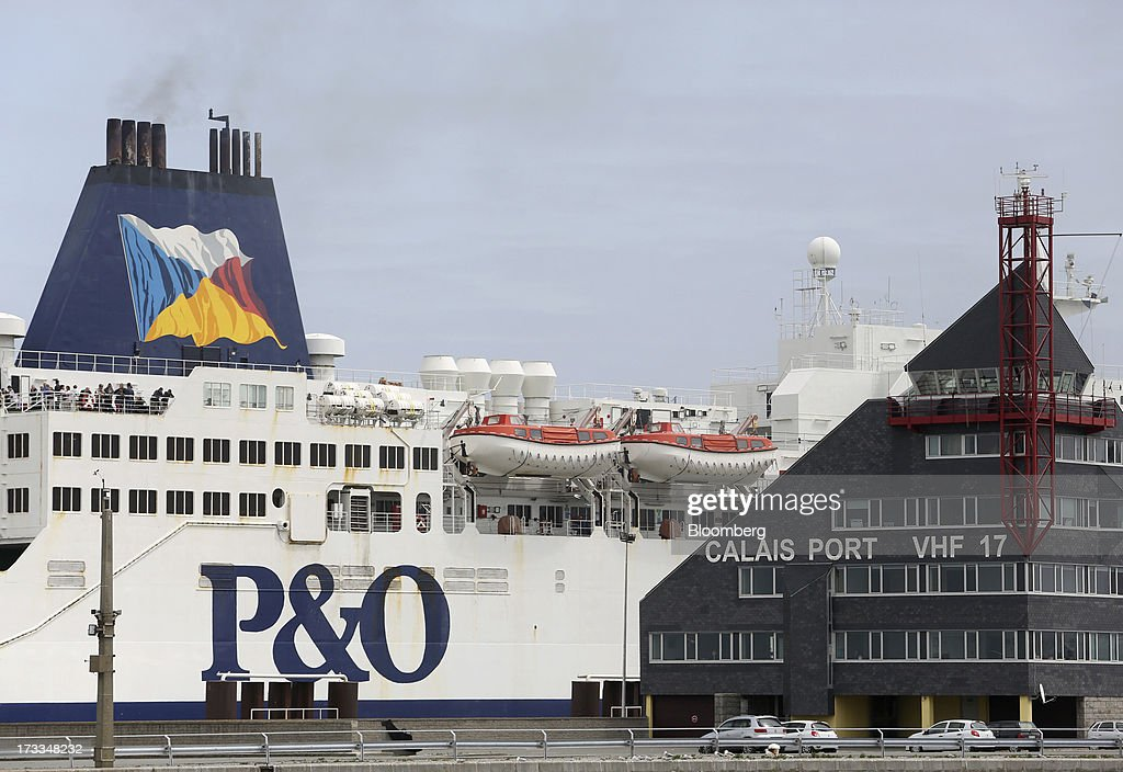 A P&O passenger ferry sits docked at a berth beyond the control tower at the Port of Calais in Calais, France, on Thursday, July 11, 2013. Groupe Eurotunnel SA was barred by the U.K. Competition Commission from operating a ferry service between France and Dover in the U.K. on concern it would give it too much dominance on the Channel traffic route. Photographer: Chris Ratcliffe/Bloomberg via Getty Images