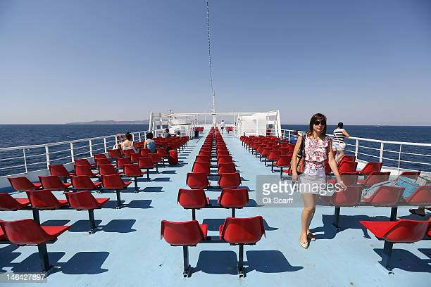 A passenger ferry travels from Piraeus the Port of Athens to the island of Aegina on June 16 2012 in Aegina Greece The Greek electorate are due to go...