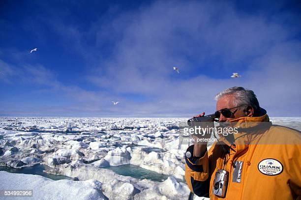 A passenger films the Arctic ice from the deck of the Russian Beaufort Sea icebreaker ship 'Kapitan Khlebnikov' on one of the Quark Expeditions...