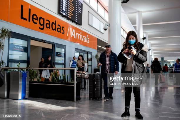 A passenger from China's Hainan Airlines flight HU7925 from Beijing remains at the Abelardo L Rodriguez International airport in Tijuana Mexico on...