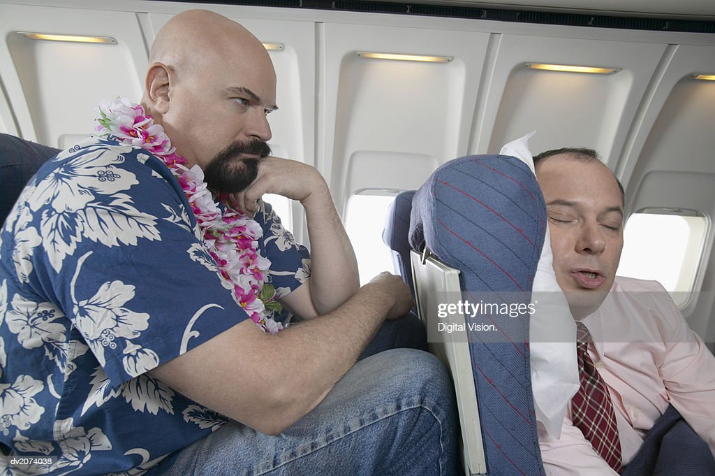 Passenger Frustrated by the Lack of Seating Space on a Aeroplane : Stock Photo