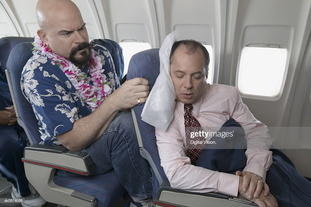 Passenger Getting Angry Over Seat Space on a Passenger Aeroplane : Stock Photo