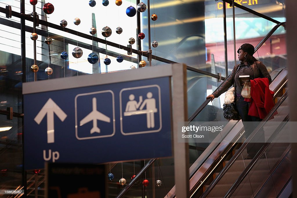 A passenger heads to the baggage claim area of O'Hare International Airport on December 21, 2012 in Chicago, Illinois. Today, the busiest air travel day of the Christmas holiday, an estimated 200,000 travelers are expected to travel through O'Hare Airport.