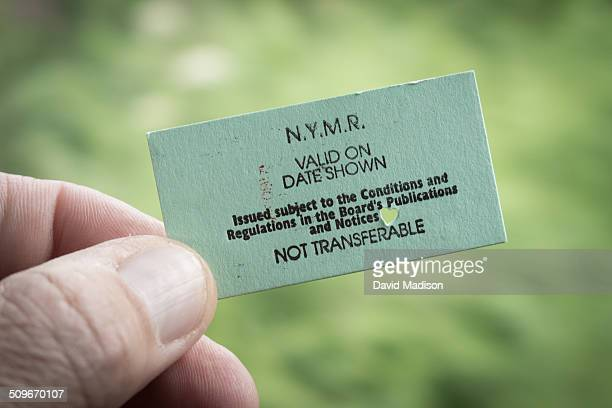 A passenger holds a train ticket while on the North York Moors Railway line in North Yorkshire England
