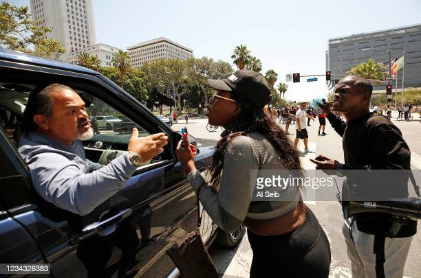 Passenger in a stopped vehicle shouts This is why you get no support as he argues with protestors as they stand in front of vehicles briefly shutting...