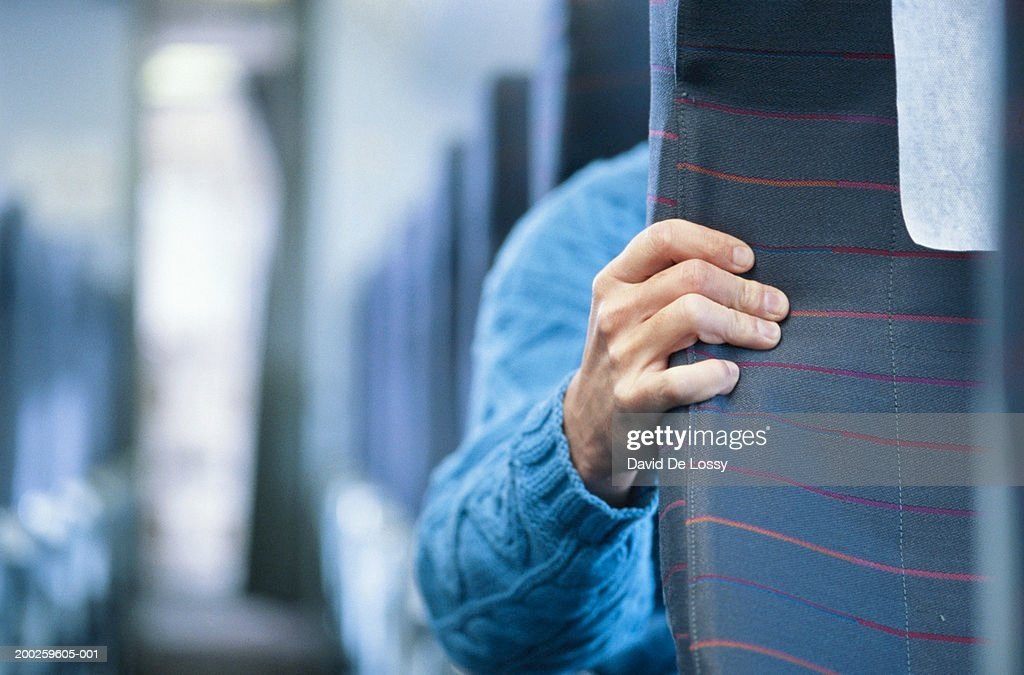 Passenger in airplane holding front seat : Stock Photo