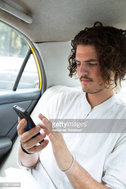 Passenger in car texting on cell phone