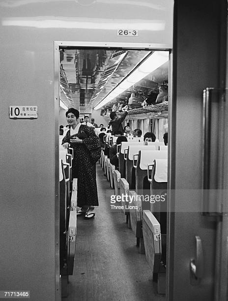 A passenger in traditional dress on board a Japanese hikari shinkansen a type of bullet train circa 1965