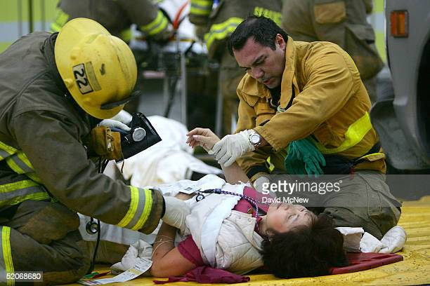 A passenger injured in a commuter train wreck is treated in the triage area January 26 2005 in Glendale California The twotrain wreck reportedly...