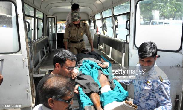 A passenger injured in Kishtwar road accident is shifted to the Government Medical College Hospital for treatment on July 1 2019 in Jammu India At...