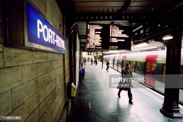 A passenger is about to take a commuter train of the RER B line at PortRoyal commuter trainstation in Paris on December 05 two days after a bomb...