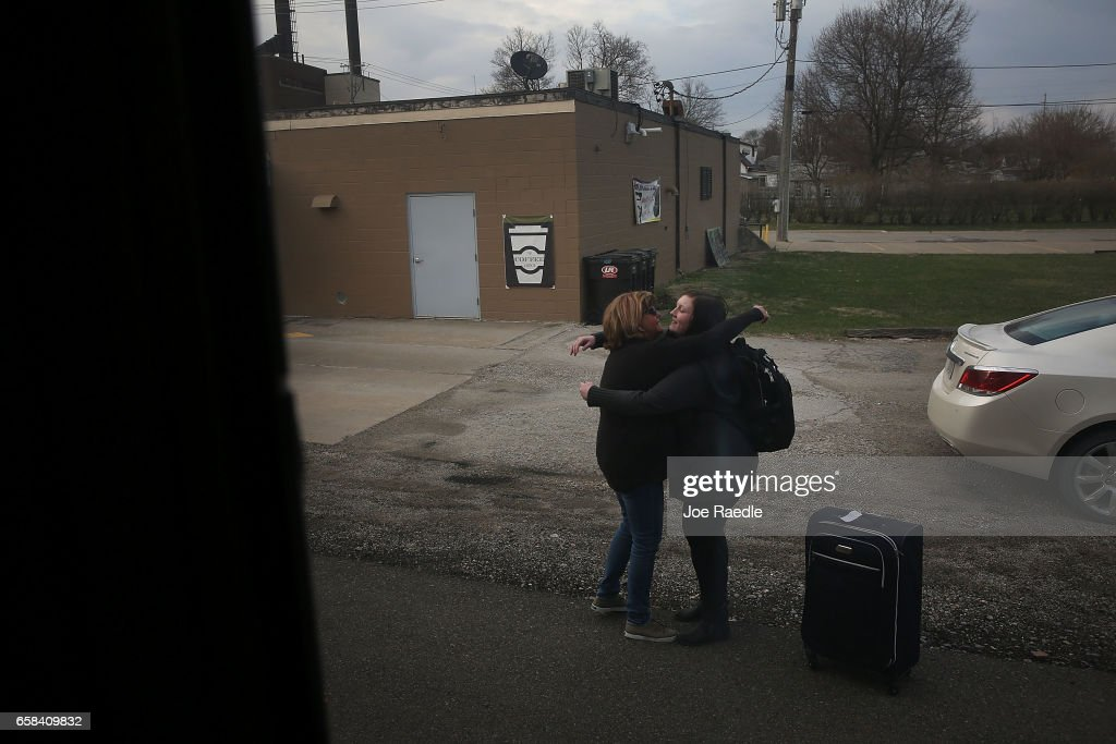 A passenger is greeted after arriving on Amtrak's California Zephyr during its daily 2,438-mile trip to Emeryville/San Francisco from Chicago that takes roughly 52 hours on March 23, 2017 in Mount Pleasant, United States. President Trump has proposed a national budget that would terminate federal support for Amtrak's long distance train services, which would affect the California Zephyr and other long distance rail lines run by Amtrak.