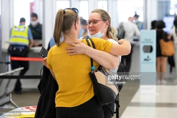 Passenger is greeted by a loved one as the first flight from Sydney arrives into Perth Airport on December 8, 2020 in Perth, Australia. Western...