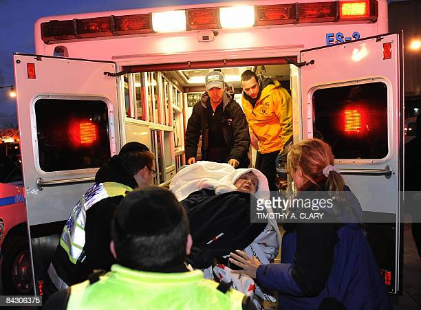 A passenger is loaded in a ambulance after being rescued from the Hudson River after a US Airways plane with more than 150 people aboard went down in...