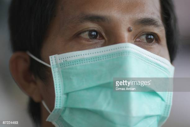 A passenger is seen wearing a mask at Hong Kong International Airport on May 14 2009 in Hong Kong China Following the 2003 SARS outbreak which was...