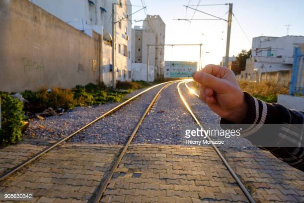 A passenger is showing his TGM train ticket The TunisGouletteMarsa is the light rail line linking the capital Tunis with La Marsa on December 21 in...
