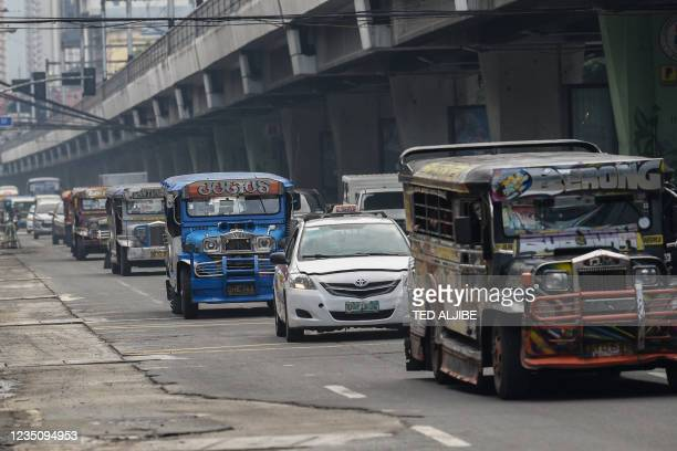 Passenger jeepneys commute along a road in Manila on September 7 a day before the authorities lift a stay-at-home order amid record Covid-19...