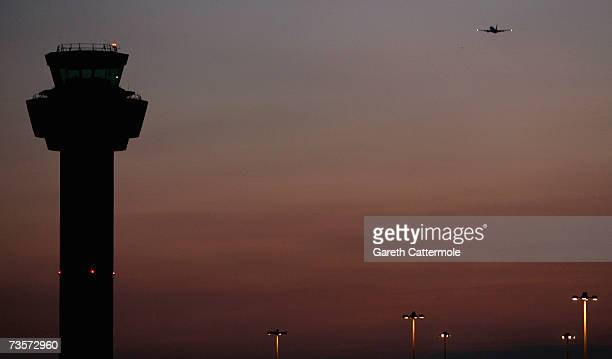 A passenger jet aircraft takes off from Stansted Airport on March 13 2007 near London England Emmissions from aircraft are a major contribution to...