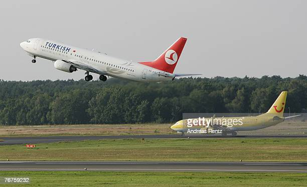 Passenger jet aircraft takes off while an other aircraft taxi to runway at Tegel airport on September 14, 2007 in Berlin, Germany.