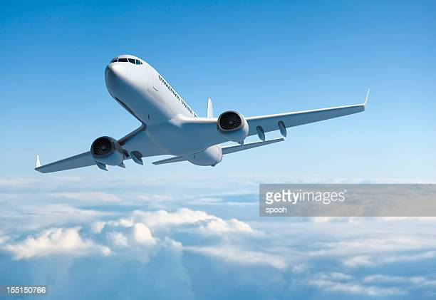 passenger jet airplane flying above clouds - aeroplane stock photos and pictures