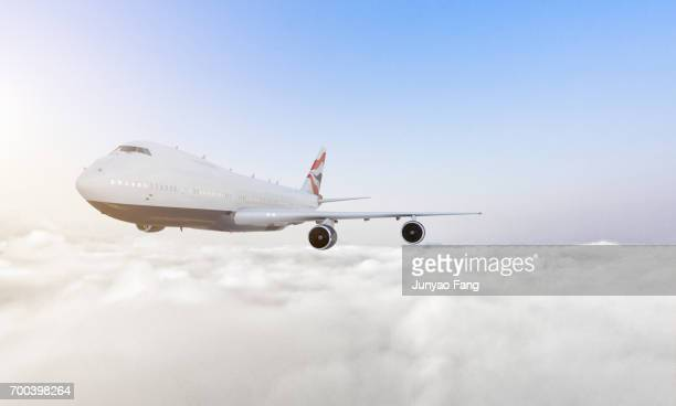 Passenger jet airplane over clouds
