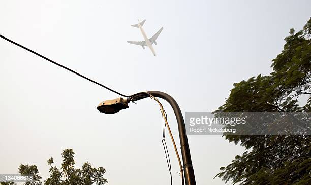 A passenger jet approaches Indira Gandhi International Airport October 22 2011 while flying over south New Delhi India With the completion of the new...