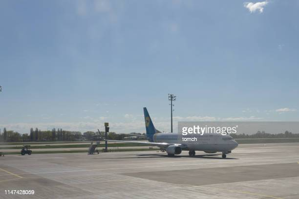 a passenger jet at the boryspil international airport, ukraine - taxiing stock pictures, royalty-free photos & images