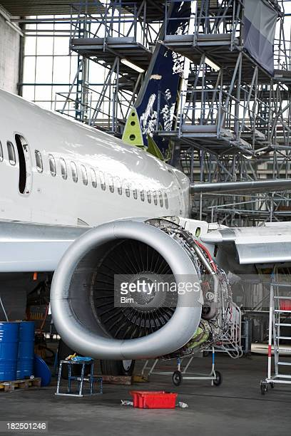 Passenger Jet During Maintenance Check in Hangar