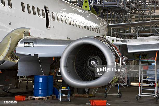 passenger jet inspection in hangar - aircraft stock photos and pictures