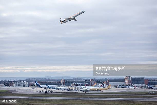 A passenger jet operated by Iberia airlines a unit of International Consolidated Airlines Group SA takes off from ToulouseBlagnac airport as the...