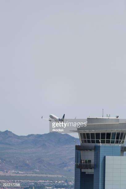 passenger jet taking off at mccarran international airport in las vegas nevada - mccarran international airport stock photos and pictures