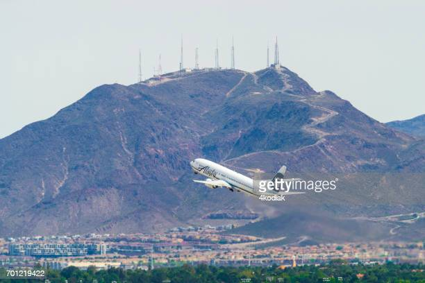 passenger jet taking off at mccarran international airport in las vegas nevada - henderson nevada stock pictures, royalty-free photos & images